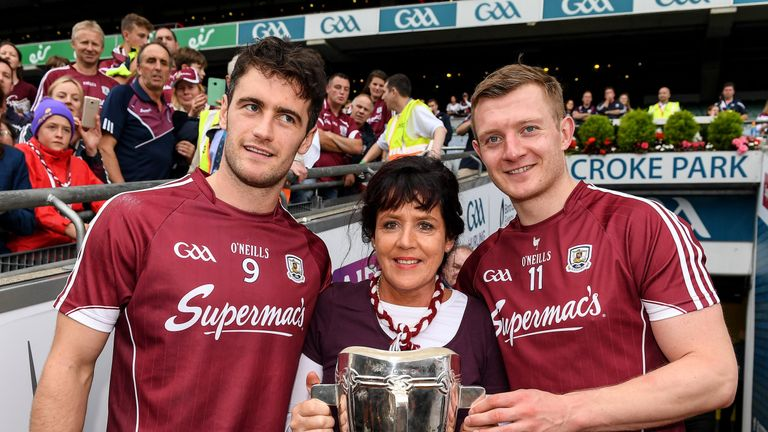 Margaret Keady with the Liam MacCarthy Cup and Galway captain, David Burke , left, and Joe Canning