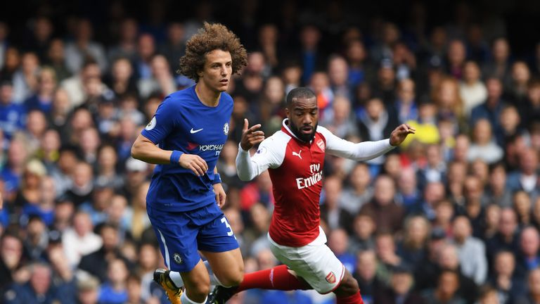 David Luiz of Chelsea attempts to take the ball away from Alexandre Lacazette of Arsenal during the Premier League match