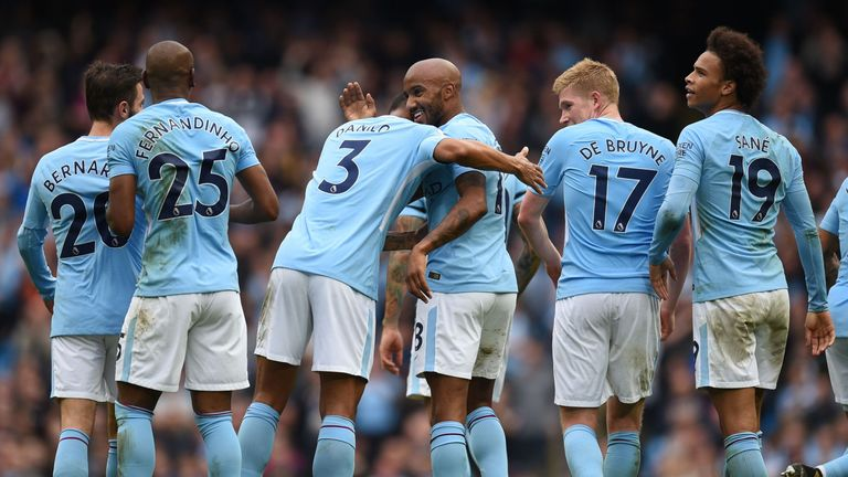 Manchester City's English midfielder Fabian Delph celebrates after scoring their fifth goal with Manchester City's Brazilian defender Danilo during the Eng