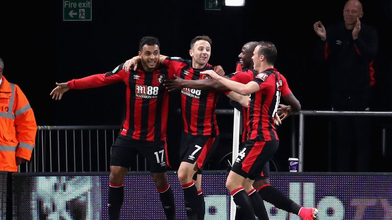 BOURNEMOUTH, ENGLAND - SEPTEMBER 19:  Joshua King of AFC Bournemouth celebrates scoring his sides first goal with team mates during the Carabao Cup Third R
