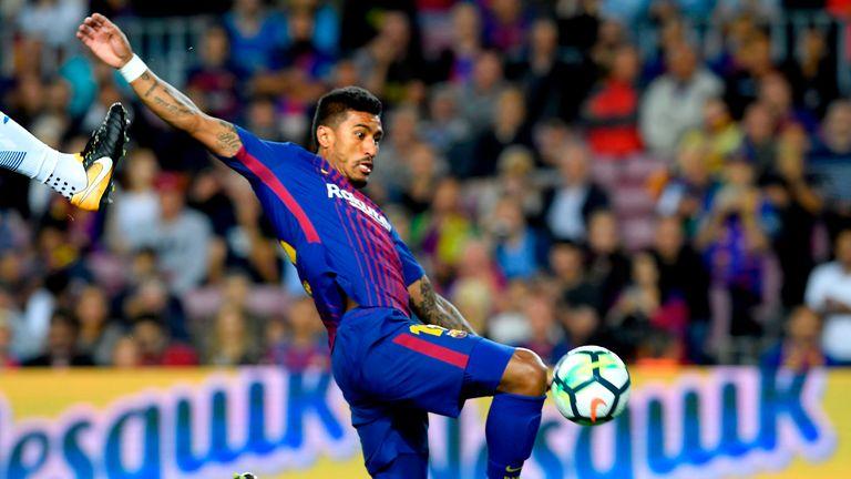 Paulinho jumps for the ball during the Spanish Liga football match Barcelona vs Espanyol at the Camp Nou stadium