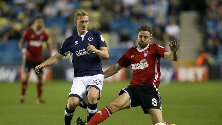 LONDON, ENGLAND - AUGUST 15: George Saville of Millwall takes the ball past Cole Skuse of Ipswich during the Sky Bet Championship match between Millwall