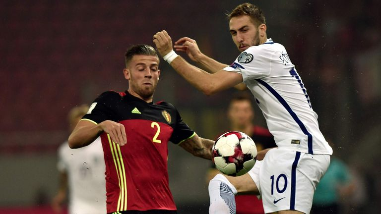 Greece's Konstantinos Fortounis (R) fights for the ball with Belgium's Toby Alderweireld during their Group H 2018 FIFA World Cup qualifier