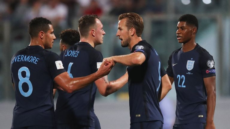 Harry Kane of England (2R) celebrates as he scores their first goal with Jake Livermore (8) during the FIFA 2018 World Cup