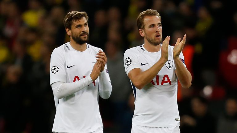 Fernando Llorente and Harry Kane applaud fans after the Champions League match against Borussia Dortmund