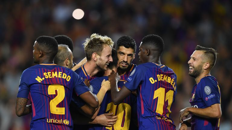 Ivan Rakitic (centre) is congratulated after doubling Barca's lead