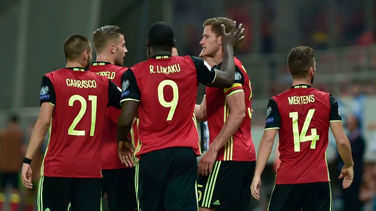 Belgium's Jan Vertonghen (C) celebrates with teammates after scoring the first goal during their Group H 2018 FIFA World Cup qualifying football match betw