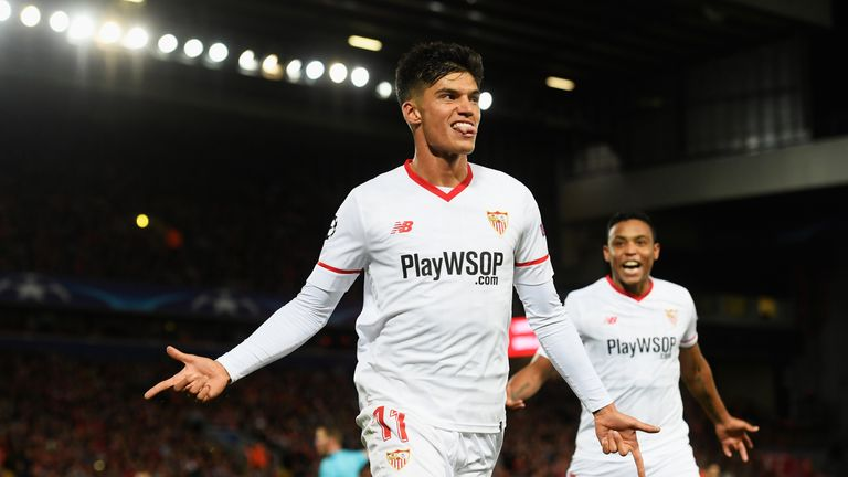LIVERPOOL, ENGLAND - SEPTEMBER 13:  Joaquin Correa of Sevilla celebrates scoring his sides second goal during the UEFA Champions League group E match betwe