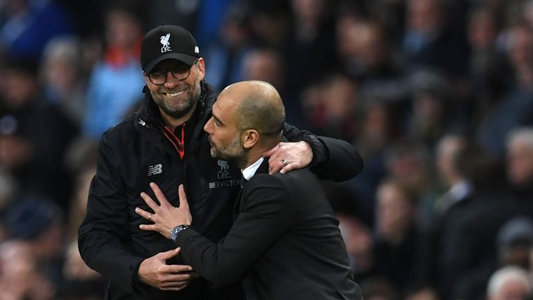 Liverpool's German manager Jurgen Klopp (L) greets Manchester City's Spanish manager Pep Guardiola after the English Premier League football match between