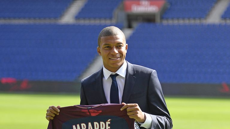 Kylian Mbappe poses for the media at Parc des Princes after making the switch from Ligue 1 rivals Monaco