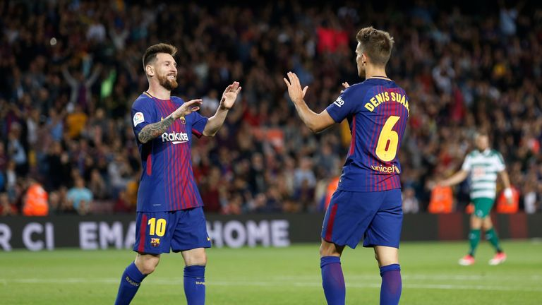 Barcelona's midfielder from Spain Denis Suarez (R) celebrates  with Barcelona's forward from Argentina Lionel Messi after scoring during the Spanish league