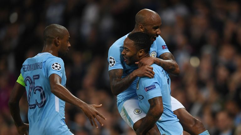 MANCHESTER, ENGLAND - SEPTEMBER 26: Raheem Sterling of Manchester City celebrates scoring his sides second goal with Fabian Delph of Manchester City and Fe