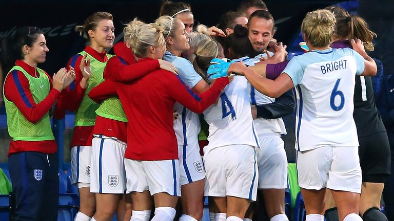 Nikita Parris and the England squad celebrate with Sampson during a 6-0 win over Russia in September 2017