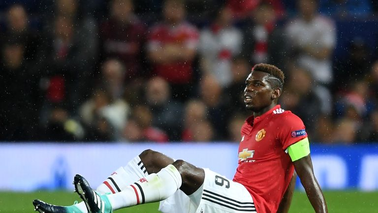 Paul Pogba goes down injured