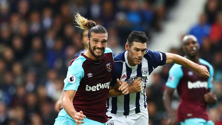 Andy Carroll and Gareth Barry compete for possession at The Hawthorns