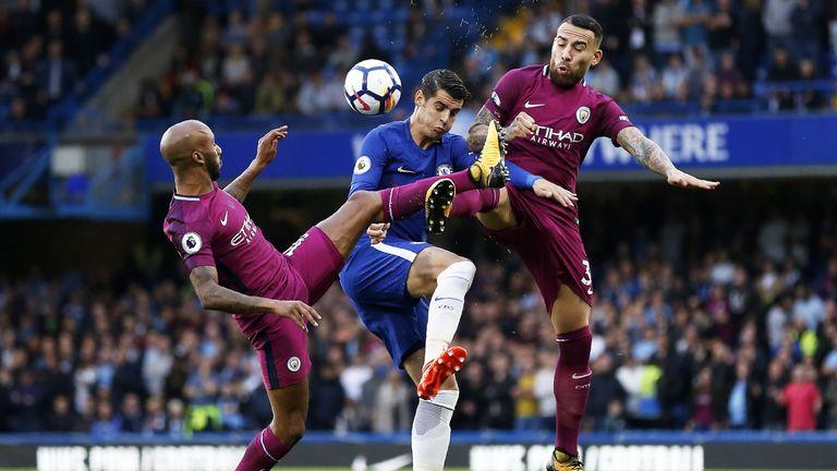 Alvaro Morata is put under pressure by Fabien Delph and Nicloas Otamendi