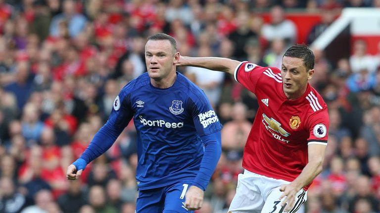 Wayne Rooney and Nemanja Matic battle for the ball