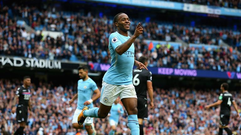MANCHESTER, ENGLAND - SEPTEMBER 23:  Raheem Sterling of Manchester City celebrates scoring his sides second goal during the Premier League match between Ma