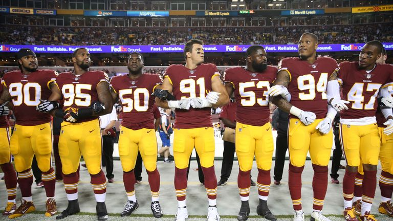 Washington Redskins players during the national anthem before their game against the Oakland Raiders