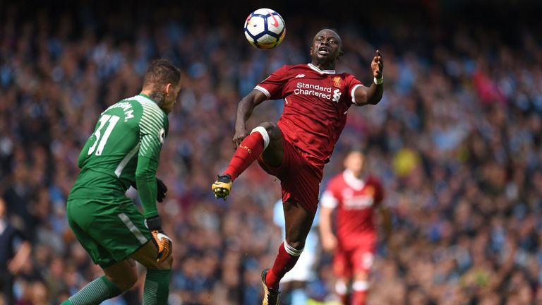 Liverpool's Senegalese midfielder Sadio Mane (R) is sent off for this challenge on Manchester City's Brazilian goalkeeper Ederson during the English Premie