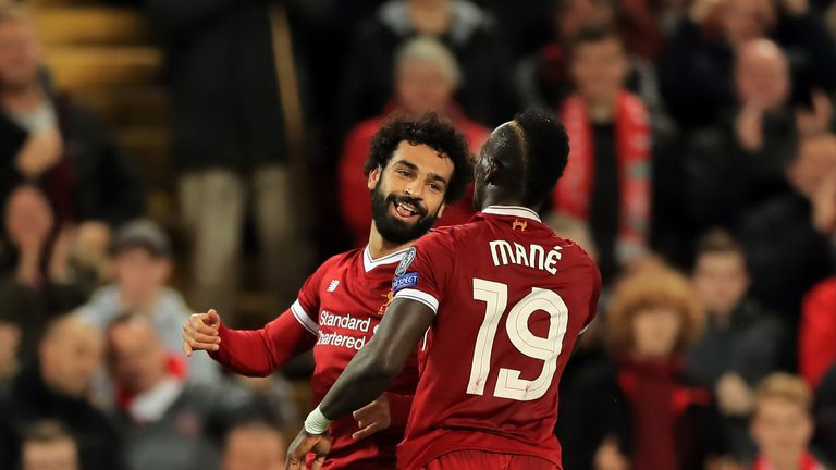 Liverpool's Mohamed Salah celebrates scoring his side's second goal of the game with Sadio Mane during the UEFA Champions League, Group E match at Anfield,