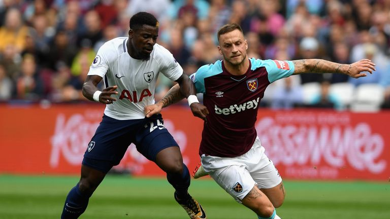 LONDON, ENGLAND - SEPTEMBER 23: Serge Aurier of Tottenham Hotspur and Marko Arnautovic of West Ham United battle for possession during the Premier League m