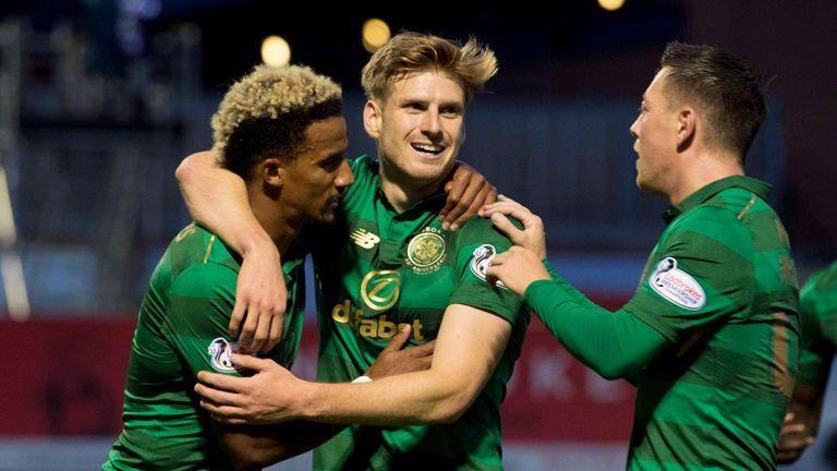 Stuart Armstrong celebrates his goal with Scott Sinclair (left) and Callum McGregor