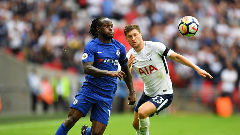 LONDON, ENGLAND - AUGUST 20: Victor Moses of Chelsea and Ben Davies of Tottenham Hotspur battle for possession.