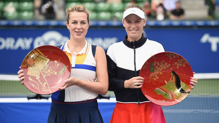 Wozniacki (right) claimed her maiden victory of the year