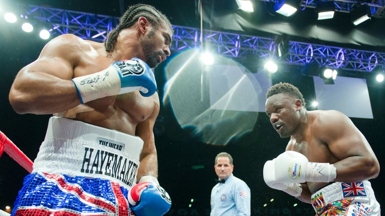 David Haye (L) throws a punch at Dereck Chisora during the WBO International and WBA Intercontinental Heavyweight Championship fight at the West Ham footba