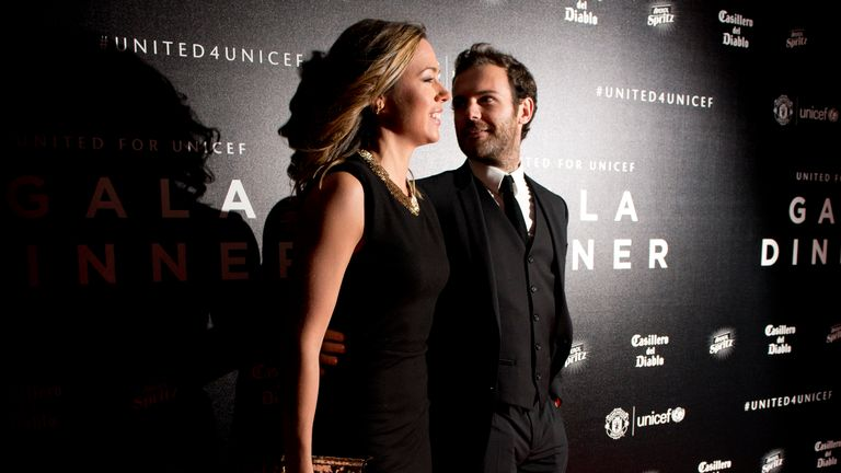Manchester United midfielder Juan Mata and his girlfriend Evelina Kamph pose for pictures on the red carpet