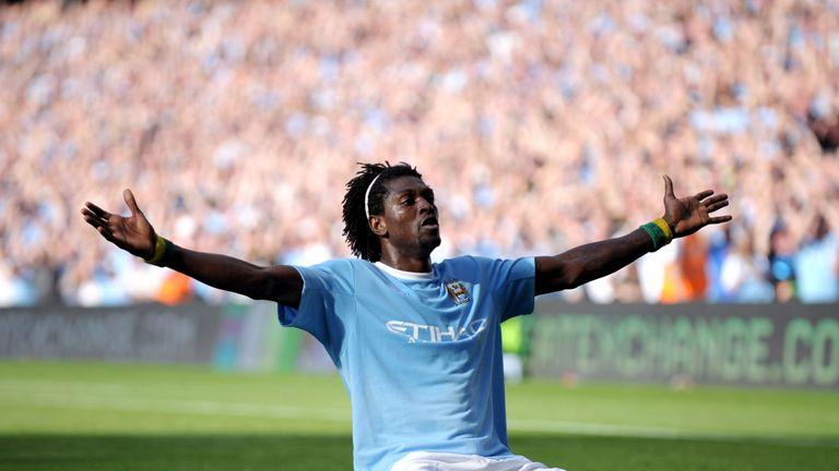 Emmanuel Adebayor celebrates in front of the Arsenal fans