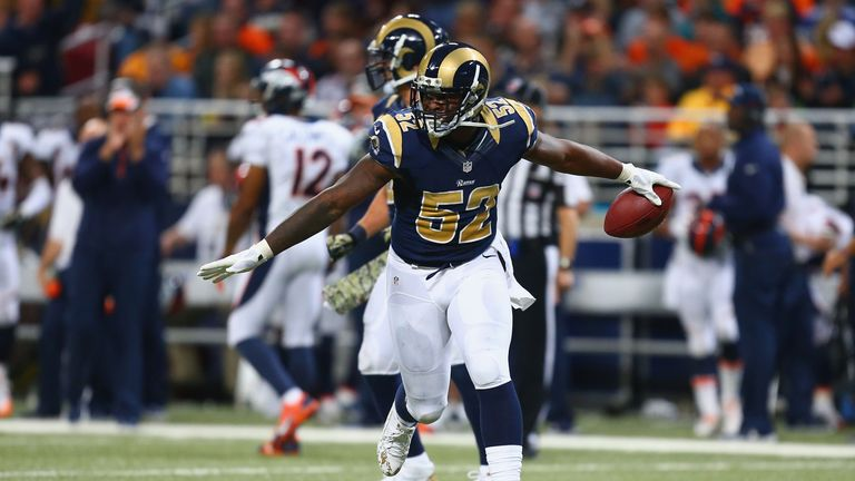 Alec Ogletree #52 of the St. Louis Rams celebrates after making an interception