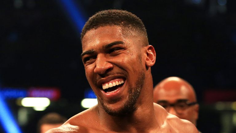 Anthony Joshua celebrates victory over Carlos Takam during their World Heavyweight Title bout in Cardiff