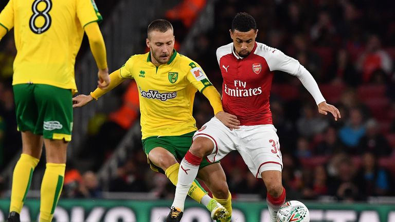 Norwich City's German midfielder Tom Trybull (L) vies with Arsenal's French midfielder Francis Coquelin during the English League Cup fourth round football