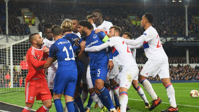 Ashley Williams (No 5) clashes with Lyon players after a challenge on Anthony Lopes (in orange)