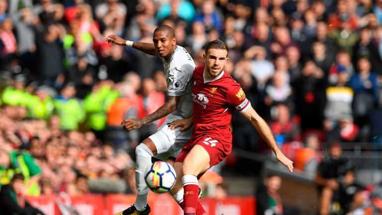 Manchester United's English midfielder Ashley Young (L) vies with Liverpool's English midfielder Jordan Henderson during the English Premier League footbal