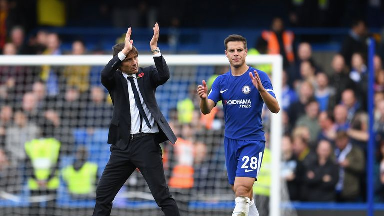 Antonio Conte and Cesar Azpilicueta celebrate Chelsea's 4-2 victory against Watford
