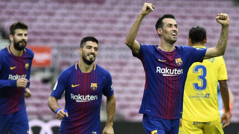 Barcelona's Spanish midfielder Sergio Busquets (R) celebrates after scoring a goal during the Spanish league football match FC Barcelona vs UD Las Palmas p