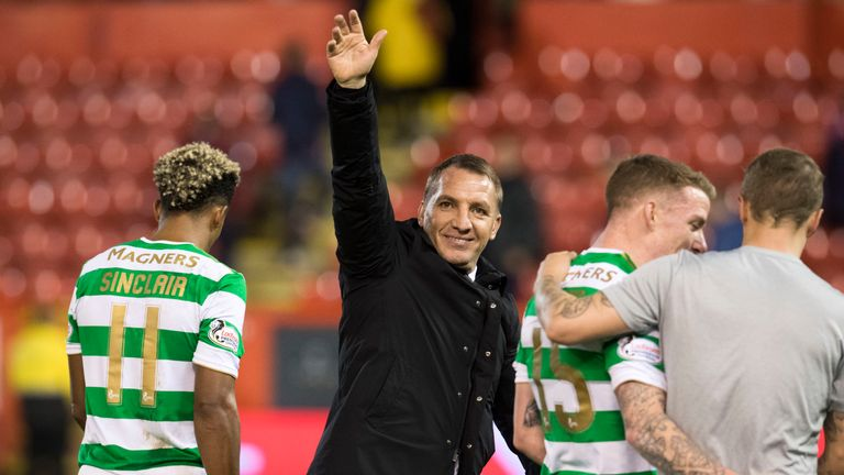 Brendan Rodgers acknowledges the travelling support at full-time at Pittodrie