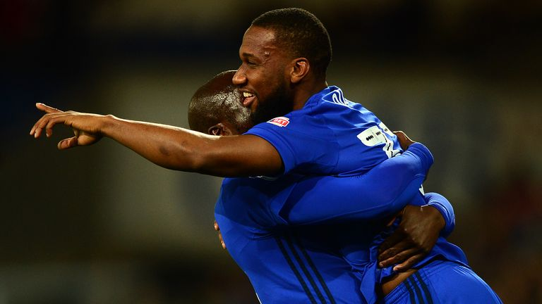 CARDIFF, WALES - OCTOBER 31: Junior Hoilett of Cardiff City celebrates scoring his sides first goal during the Sky Bet Championship match between Cardiff C