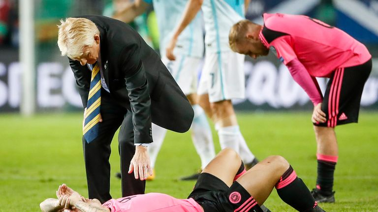 LJUBLJANA, SLOVENIA - OCTOBER 08: Head coach Gordon Strachan (top) comforts Leigh Griffiths of Scotland after the FIFA 2018 World Cup Qualifier match betwe
