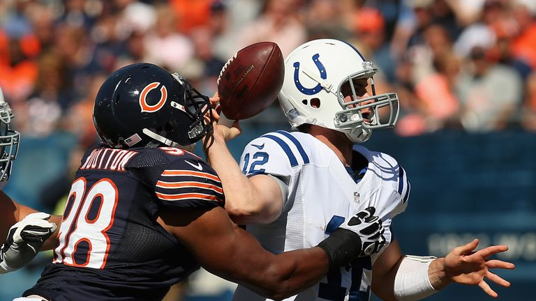 Andrew Luck fumbles the ball as he is hit by Corey Wootton of the Chicago Bears