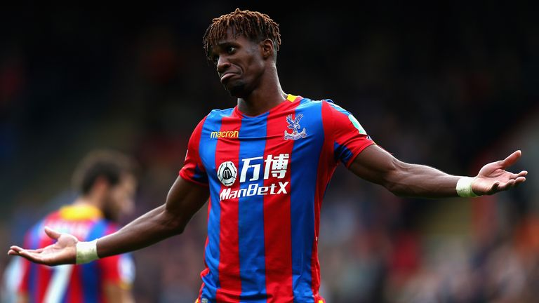 Wilifried Zaha gestures during Crystal Palace's match with west Ham in the Premier League.