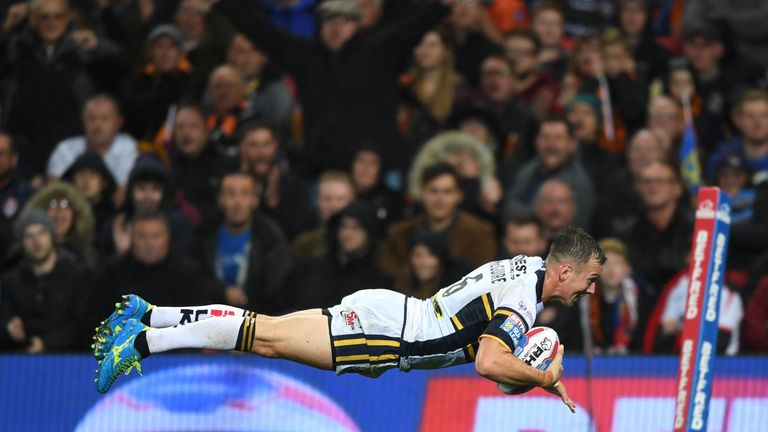 Danny McGuire dives over to score his first try