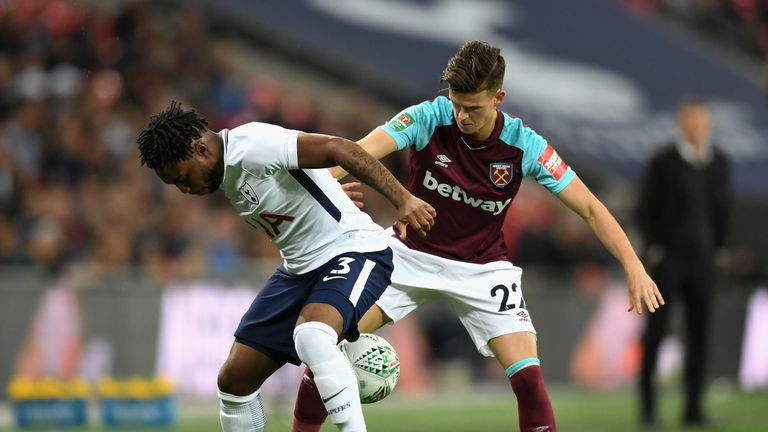 Danny Rose and Sam Byram battle for the ball at Wembley