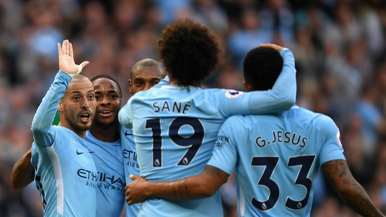 MANCHESTER, ENGLAND - OCTOBER 14: David Silva of Manchester City celebrates scoring his sides third goal with his Manchester City team mates during the Pre