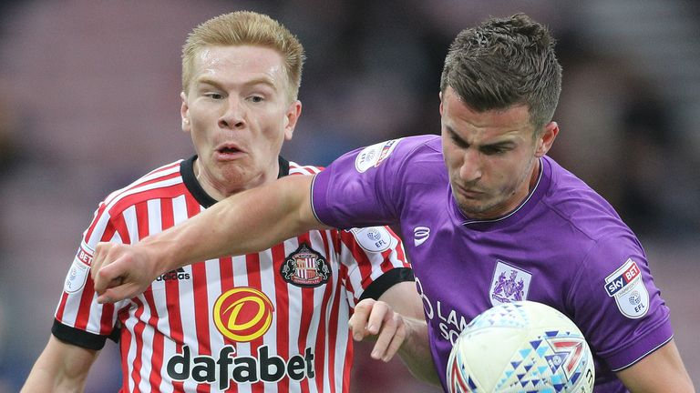 Sunderland's Duncan Watmore and Bristol's Joe Bryan battle for the ball during the Sky Bet Championship match at the Stadium of Light