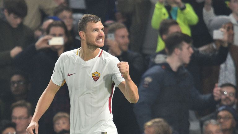 Roma's Bosnian striker Edin Dzeko celebrates after scoring his second goal during a UEFA Champions league group stage football match between Chelsea and Ro