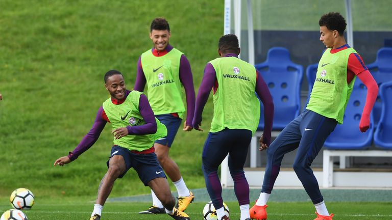 BURTON-UPON-TRENT, ENGLAND - OCTOBER 02:  Raheem Sterling, Alex Oxlade-Chamberlain, Jermain Defoe and Dele Alli of England in action during an England trai